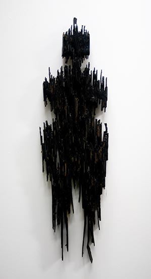 Figure, charred and painted cardboard 2013 by Ty Bowman